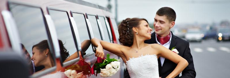 Bride & Groom In Front Of Limo